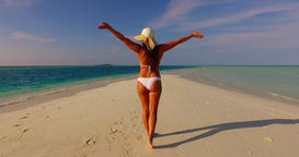 v07843 Maldives white sandy beach 1 person young beautiful lady sunbathing alone Live Action