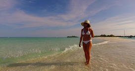 v07846 Maldives white sandy beach 1 person young beautiful lady sunbathing alone Live Action