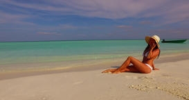 v07857 Maldives white sandy beach 1 person young beautiful lady sunbathing alone Live Action