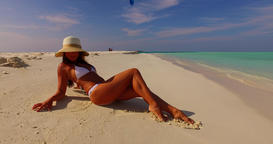v07861 Maldives white sandy beach 1 person young beautiful lady sunbathing alone Live Action