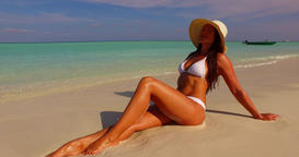 v07868 Maldives white sandy beach 1 person young beautiful lady sunbathing alone Live Action
