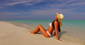 v07874 Maldives white sandy beach 1 person young beautiful lady sunbathing alone Live Action