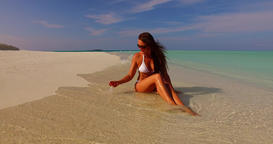v07881 Maldives white sandy beach 1 person young beautiful lady sunbathing alone Footage