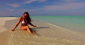 v07882 Maldives white sandy beach 1 person young beautiful lady sunbathing alone Live Action
