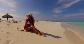 v07883 Maldives white sandy beach 1 person young beautiful lady sunbathing alone Live Action