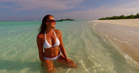 v07876 Maldives white sandy beach 1 person young beautiful lady sunbathing alone Live Action