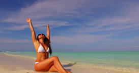 v07890 Maldives white sandy beach 1 person young beautiful lady sunbathing alone Live Action