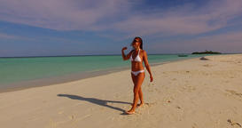 v07909 Maldives white sandy beach 1 person young beautiful lady sunbathing alone Live Action
