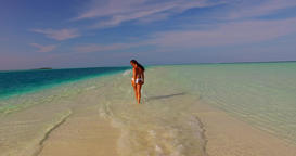 v07912 Maldives white sandy beach 1 person young beautiful lady sunbathing alone Footage