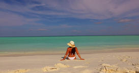 v07916 Maldives white sandy beach 1 person young beautiful lady sunbathing alone Live Action