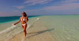v07915 Maldives white sandy beach 1 person young beautiful lady sunbathing alone Live Action