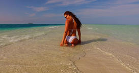 v07932 Maldives white sandy beach 1 person young beautiful lady sunbathing alone Live Action