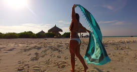 v07935 Maldives white sandy beach 1 person young beautiful lady sunbathing alone Live Action