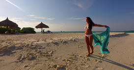 v07934 Maldives white sandy beach 1 person young beautiful lady sunbathing alone Live Action