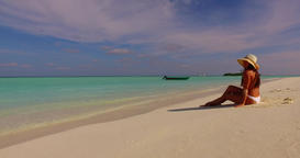 v07938 Maldives white sandy beach 1 person young beautiful lady sunbathing alone Live Action