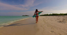 v07944 Maldives white sandy beach 1 person young beautiful lady sunbathing alone Live Action