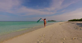 v07945 Maldives white sandy beach 1 person young beautiful lady sunbathing alone Live Action