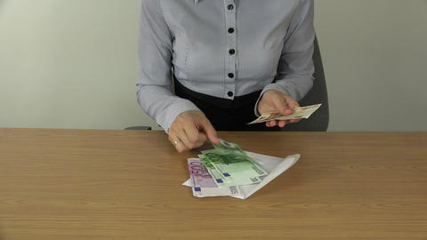 Woman hands count money euro banknotes in envelope. 4K Footage