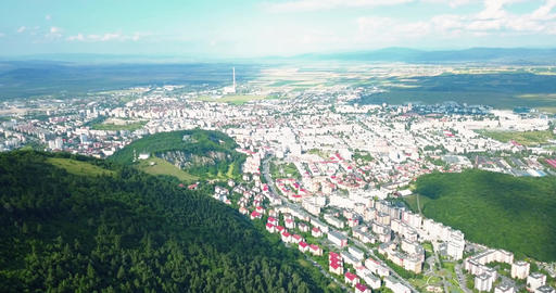 Aerial Drone Flyover Carpathian Mountains And Brasov City Live Action