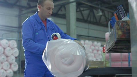 Closeup Worker Fixes Foam Rubber Pack with Adhesive Tape Footage