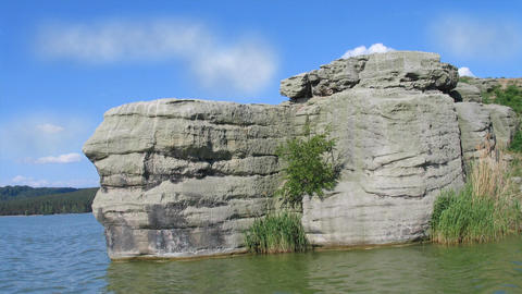 Interesting sandstone rock in the water, Machovo jezero, lake in Czech Republic, Animation