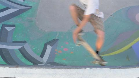 Skateboarder doing tricks on Concrete Skatepark Ramp - Slow Motion Footage