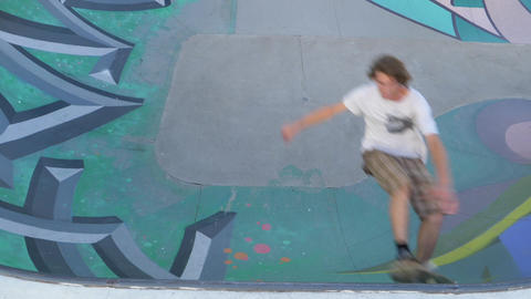 Skateboarder doing tricks on Concrete Skatepark Ramp - Slow Motion Footage