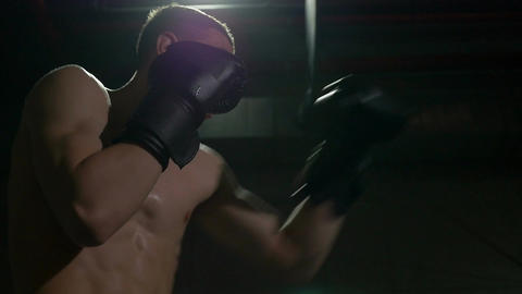 Kickboxer exercising boxing inside sport gym in slow motion Footage