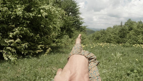 Man Sits And Throws His Leg by The Arm And Gets into his... Stock Video Footage