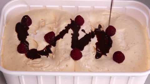 Pouring Chocolate Sauce On Ice Cream Footage