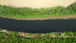 Aerial: above view of river surrounded with forest, houses and arable land. Gorn Footage