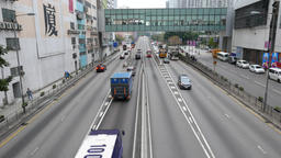 Easy traffic on Kwai Chung Road at Hong Kong, pedestrian passage over expressway Footage