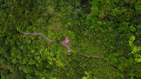 Aerial shot of hiking trail in mountain forest, concrete steps and shelter Footage