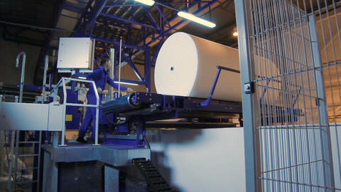 Motion to Worker Operating at Machine Tool with Foam Rubber Roll Footage