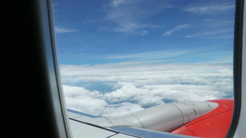 clouds sky view through an airplane, Traveling by air. Flying above the clouds Footage