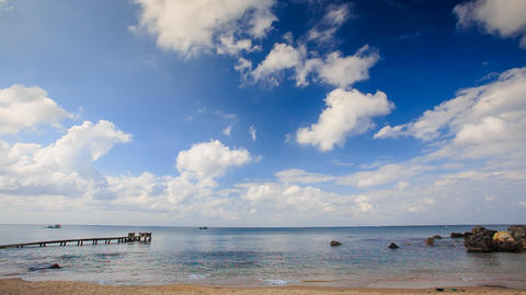 Sea Bay with Wooden Pier Rocks Waves Splash against Sky Footage