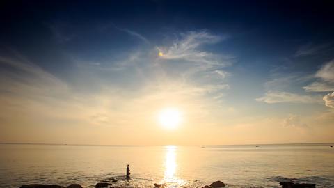 Silhouette in Sea by Beach Sun Path on Water Sun on Skyline Footage