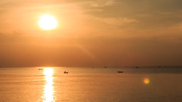 Motion from Silhouette in Sea to Bright Sun Path Boats at Sunset Footage