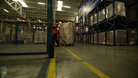 Carring boxes across warehouse Footage