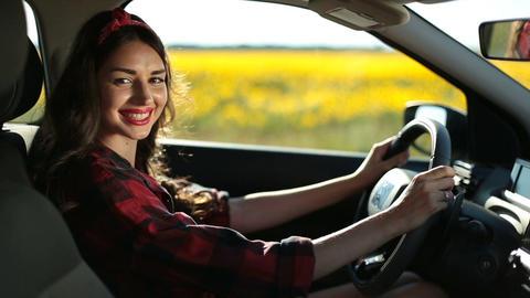 Portrait of stunning woman fastening car seatbelt Footage