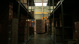 Forklifts transports boxes Live Action