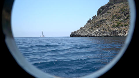 View Of The Coast Of The Mediterranean Sea Through The Porthole Of The Ship