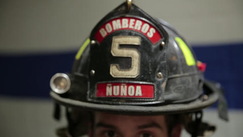 Fireman putting on helmet Live Action