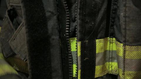Fireman zipping jacket Footage