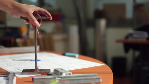 Hand placing structure on desk Footage