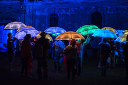 Colorful umbrellas illuminated by led lamps in the night フォト
