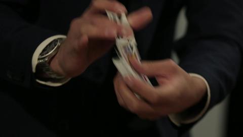 Magician shuffling cards Footage