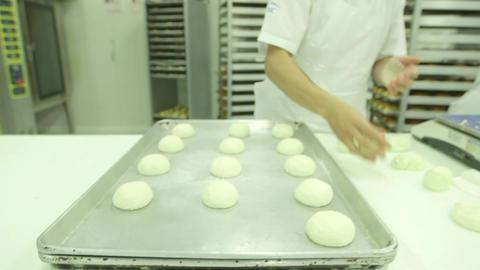 Baker rolling dough Footage