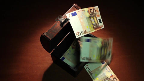 Shadow economy. 50 Euro. Money falls in the ancient chest. 500 Euro banknotes. A Footage