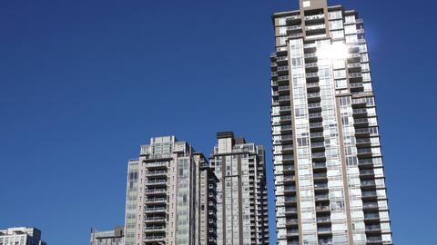 Motion of high-rise residential new buildings on blue sky with 4k resolution Image